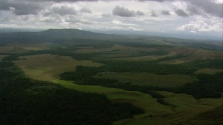 AF0001_000556 - HD stock footage aerial video tilt from jungle for a view of green hills in Southern Venezuela