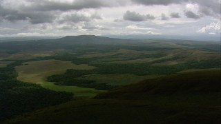 AF0001_000557 - HD stock footage aerial video tilt from jungle and hills to the clouds in Southern Venezuela