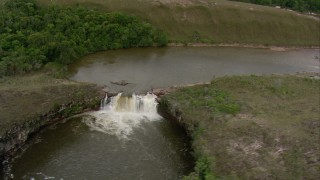 AF0001_000560 - Aerial stock footage of Orbit a river waterfall in Southern Venezuela