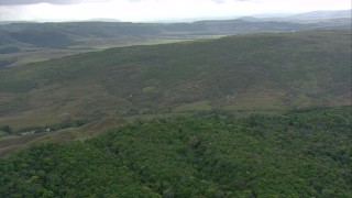 AF0001_000561 - HD stock footage aerial video zoom from jungle to reveal wide view of a mountain ridge in Southern Venezuela
