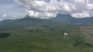AF0001_000563 - Aerial stock footage of Mountain peaks, jungle, and river waterfalls, Guiana Highlands, Southern Venezuela