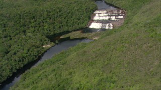 AF0001_000564 - Aerial stock footage of Tilt from Guiana Highlands peaks to a bird's eye view of river waterfalls, Southern Venezuela