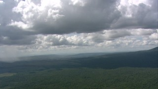 AF0001_000567 - HD stock footage aerial video of clouds over the jungle and distant rain showers in Southern Venezuela