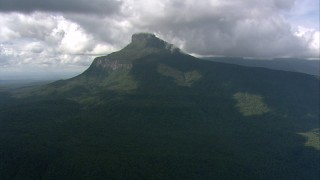 AF0001_000570 - HD stock footage aerial video of clouds over jungle and a Guiana Highlands mountain peak in Southern Venezuela