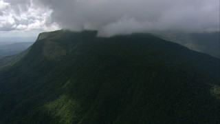 AF0001_000574 - Aerial stock footage of Dense cloud cover over a mountain and jungle in Southern Venezuela