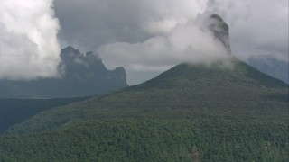 AF0001_000576 - HD stock footage aerial video of mountain peaks and jungle under low clouds in Southern Venezuela