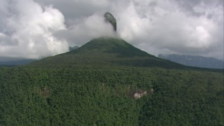 AF0001_000577 - HD stock footage aerial video zoom out to a wider view of mountain peaks covered with jungle in Southern Venezuela