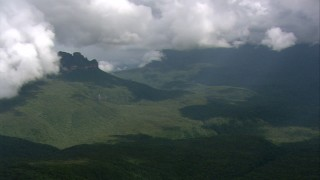 AF0001_000582 - HD stock footage aerial video pan across a jungle landscape and mountains in Southern Venezuela
