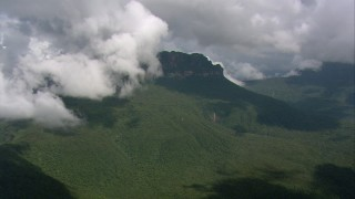 AF0001_000584 - HD stock footage aerial video of jungle around a jagged mountain peak in Southern Venezuela