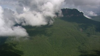 AF0001_000585 - HD stock footage aerial video approach clouds over dense jungle and mountain peak in Southern Venezuela