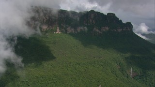 AF0001_000586 - HD stock footage aerial video approach a flat mountain above dense jungle in Southern Venezuela