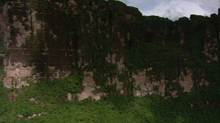 AF0001_000587 - HD stock footage aerial video pan across steep mountain slopes and jungle vegetation in Southern Venezuela
