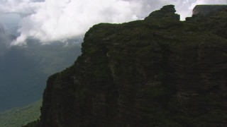 AF0001_000592 - HD stock footage aerial video tilt from jungle to reveal steep mountain cliffs in the Guiana Highlands, Southern Venezuela