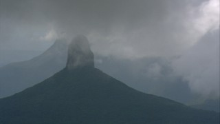 AF0001_000595 - HD stock footage aerial video of misty clouds around a mountain peak over jungle in Southern Venezuela