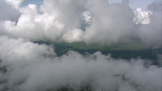 AF0001_000597 - Aerial stock footage of Pan across dense clouds to reveal steep cliffs of a peak in Southern Venezuela