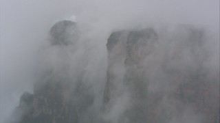 AF0001_000598 - Aerial stock footage of Misty clouds around steep cliffs in Southern Venezuela
