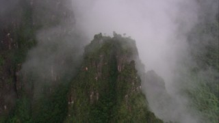 AF0001_000601 - HD stock footage aerial video of approaching a mist shrouded mountain, Southern Venezuela