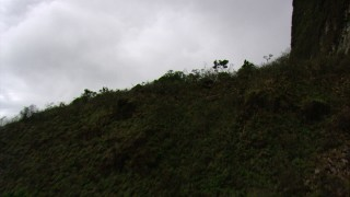 AF0001_000605 - HD stock footage aerial video fly over a rocky slope to reveal savanna in Southern Venezuela