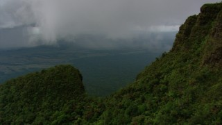 AF0001_000607 - HD stock footage aerial video fly over a rugged slope to reveal jungle below in Southern Venezuela