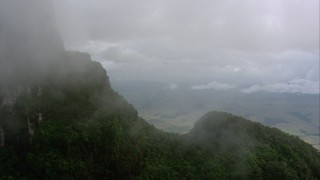 AF0001_000608 - Aerial stock footage of Approaching a mountain slope and mist, Southern Venezuela