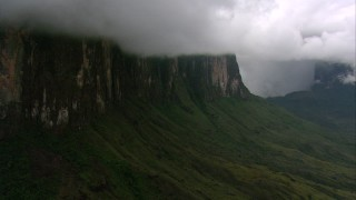 AF0001_000610 - HD stock footage aerial video of mountain peaks with cloud shrouded summits, Southern Venezuela