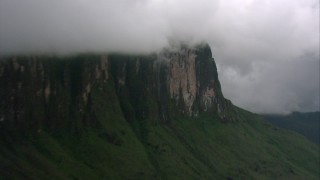 AF0001_000611 - HD stock footage aerial video zoom closer to a mountain waterfall in Southern Venezuela