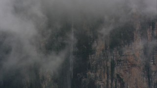 AF0001_000612 - HD stock footage aerial video of a waterfall on a mountain cliff in Southern Venezuela