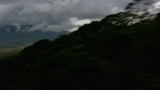 AF0001_000622 - HD stock footage aerial video zoom wider to a view of dense clouds, hilly savanna, reveal jungle and mountains in Southern Venezuela