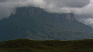 AF0001_000625 - HD stock footage aerial video of a view of a mountain partially hidden by clouds in Southern Venezuela