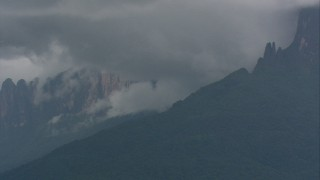 AF0001_000626 - HD stock footage aerial video of peaks partially covered by jungle and dense clouds in Southern Venezuela