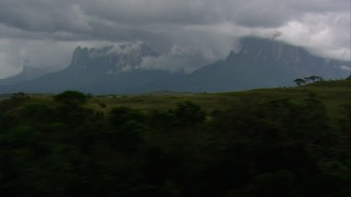 AF0001_000630 - Aerial stock footage of Cloud-covered mountains seen from hills and jungle in Southern Venezuela