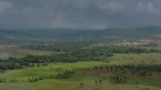 AF0001_000640 - HD stock footage aerial video zoom out from a hotel to reveal a small town and rural homes in Southern Venezuela