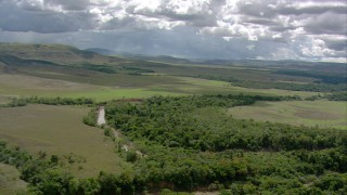 AF0001_000653 - HD stock footage aerial video tilt from a bird's eye view of a river and jungle in Southern Venezuela