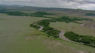 AF0001_000655 - Aerial stock footage of Following a river through savanna in Southern Venezuela