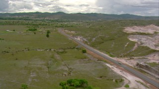 AF0001_000674 - Aerial stock footage of A country highway, small farms, and rural homes in Southern Venezuela
