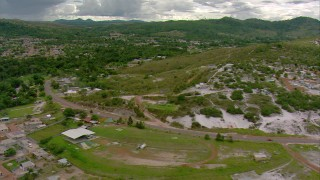 AF0001_000677 - Aerial stock footage of Follow a highway through a small town in Southern Venezuela