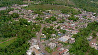 AF0001_000678 - Aerial stock footage of Fly over streets through a small town in Southern Venezuela