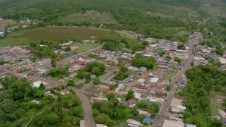 AF0001_000679 - HD stock footage aerial video pan across a small town in Southern Venezuela