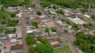 AF0001_000680 - Aerial stock footage of Flying over roads and buildings in a small town, Southern Venezuela