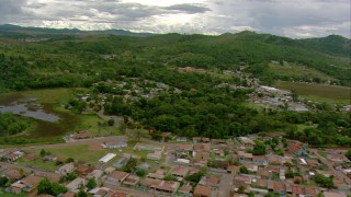 AF0001_000687 - HD stock footage aerial video fly over homes in a small town to approach a hotel in Southern Venezuela