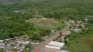 AF0001_000689 - HD stock footage aerial video of flying away from a hotel in a small town in Southern Venezuela