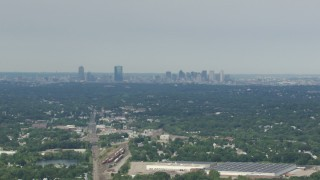 AF0001_000696 - Aerial stock footage of Approaching Downtown Boston skyline from Readville, Massachusetts