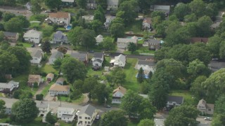 AF0001_000698 - HD stock footage aerial video of a suburban residential neighborhood in Readville, Massachusetts