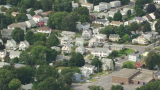 AF0001_000699 - HD stock footage aerial video of flying by a suburban neighborhood, Readville, Massachusetts