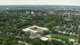 AF0001_000712 - HD stock footage aerial video fly over Brookline High School and residential neighborhoods, Brookline, Massachusetts