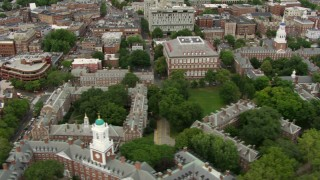 AF0001_000717 - Aerial stock footage of Flyby Eliot House, Lowell House and campus buildings at Harvard University, Cambridge, Massachusetts