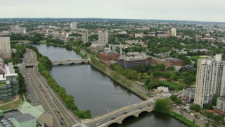 AF0001_000718 - HD stock footage aerial video office buildings across the Charles River, reveal Harvard University, Cambridge, Massachusetts