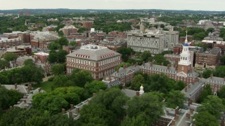 AF0001_000720 - HD stock footage aerial video follow the Charles River to approach Lowell House at Harvard University, Cambridge, Massachusetts