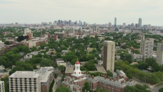 AF0001_000725 - HD stock footage aerial video fly over Dunster House at Harvard University to approach Cambridge and Downtown Boston, Massachusetts