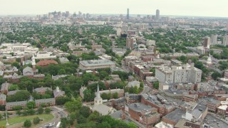 AF0001_000732 - HD stock footage aerial video tilt from Memorial Library at Harvard University to reveal Downtown Boston, Massachusetts